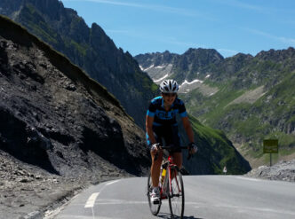 Female cyclist summiting the Col du Tourmalet