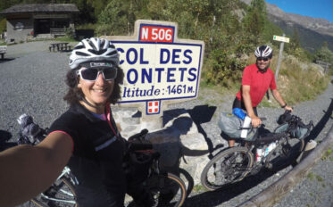 Two bike riders at the top of Col des Montets