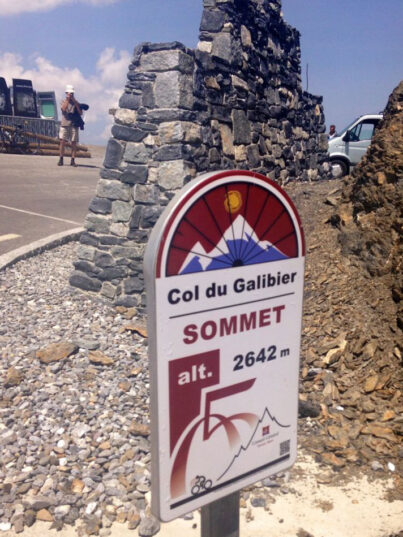 A sign at the top of Col du Galibier with the altitude