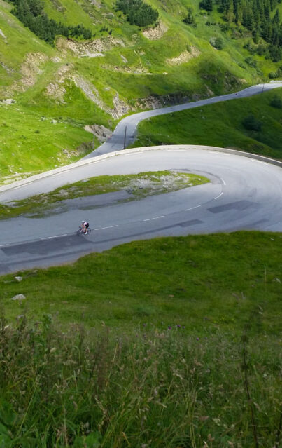 Looking down at a cyclist on the road to Luz Ardiden in the Pyrenees