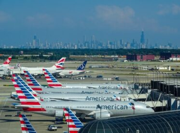 American Airlines planes sitting at an airport terminal
