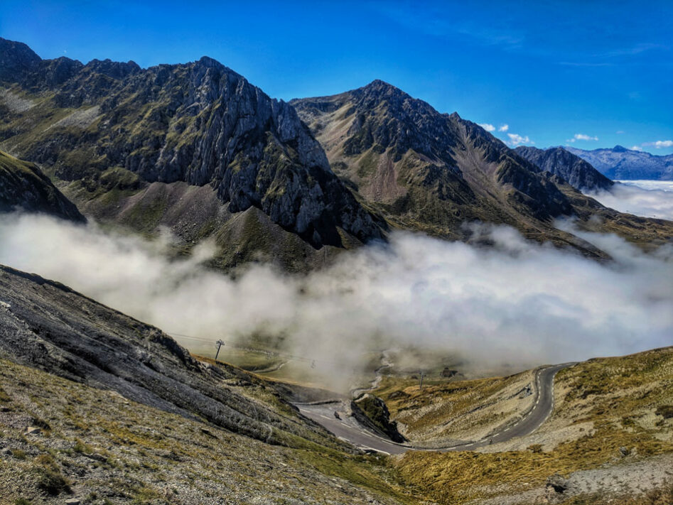 Clouds in the valley on from the top of Col du Tourmalet in the Pyrenees
