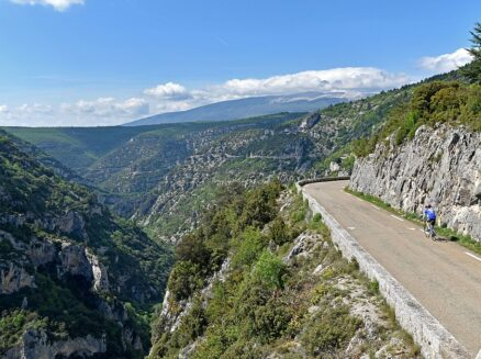A cyclist riding along the stunning balcony road of the Gorges de la Nesque