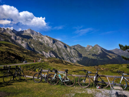Bikes leaning against a fence at the top of Col du Soulor in the Pyrenees