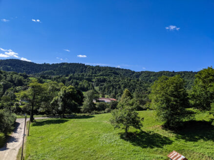 View of lush green meadows and mountains on the Saint Giron to Foix Voie Verte in the Ariege Pyrenees