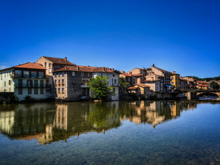 Saint-Girons village houses reflected in the Salat River