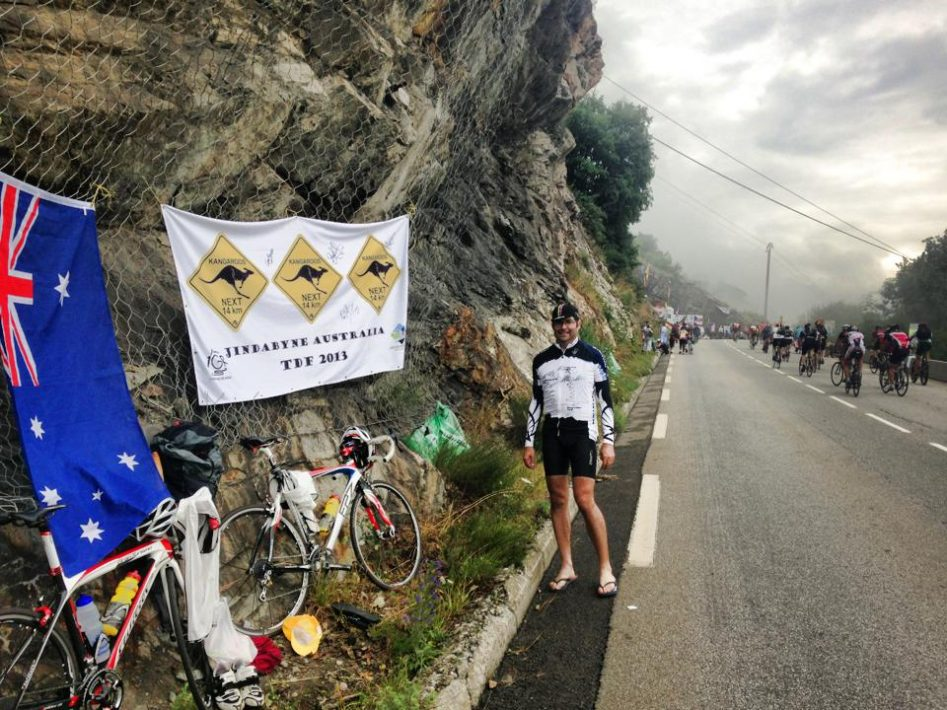 Fans lining the road with banners on the TDF Alpe d'Huez stage