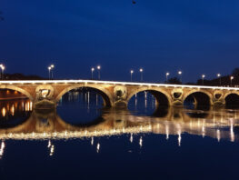 Toulouse bridge at night reflecting in the river