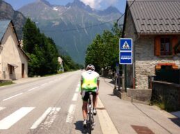 A male cyclist at the beginning of the ride to Alpe d'Huez in the French Alps