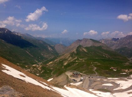 View from the summit looking at the road of the Col du Galibier a famous climb of the French Alps