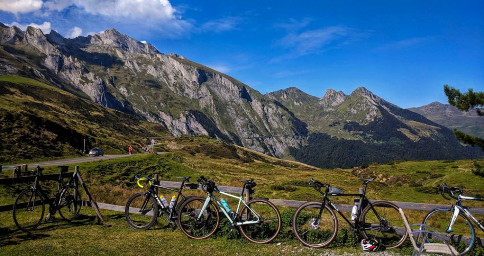 Five road bikes parked at the summit of Col du Soulor in teh French Pyrenees