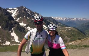 Two cyclists at the top of the Col du Tourmalet summit in the Pyrenees
