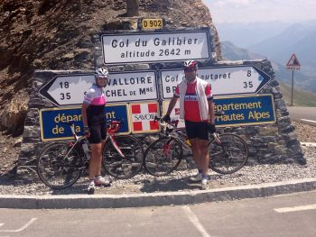 cyclists on a ride in the French Alps in front of col du galibier