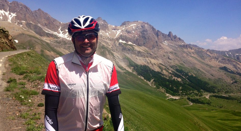 A male cyclist cycling the Col du Galibier a famous TDF ride in the French Alps