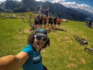cycling tour group at summit of Col d'Aubisque in the French Pyrenees