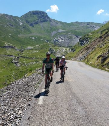Three riders descending the Col de Tentes cycling climb in the Pyrenees.
