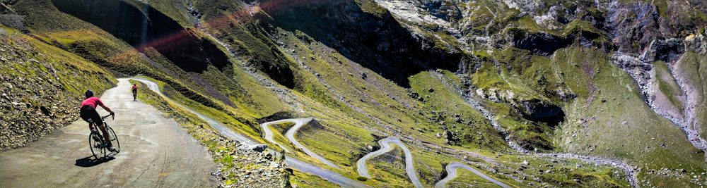 Two cyclists descending the switchback road of Cirque de troumouse. A lesser known climb you've never heard of in the pyrenees