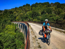 A cyclist on a cycle our riding on the Viaduct which is located on the Foix to Saint GIrons Voie Verte in the Ariege Pyrenees