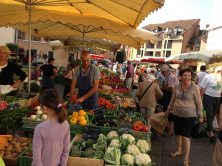 Shoppers at a produce stall at the Annecy French food market