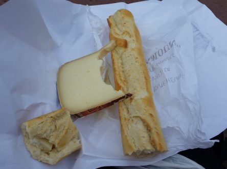 slice of Brebis cheese and baguette