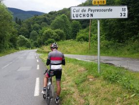 A cyclist in the French Pyrenees cycling Col du Peyresourde