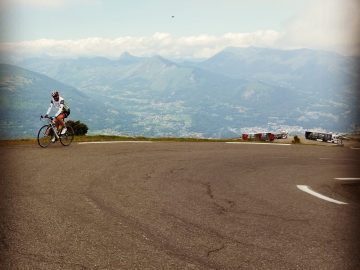 Male cyclist riding in the French Pyrenees on the Col du Tramassel