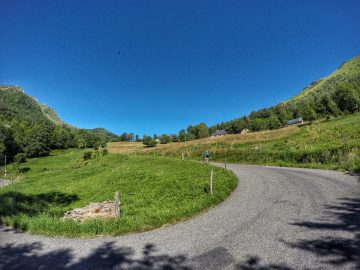 Bike rider cycling the Col des Borderes hairpin bend in the Pyrenees