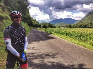 cycling around Lourdes in the French Pyrenees by lush wheatfields