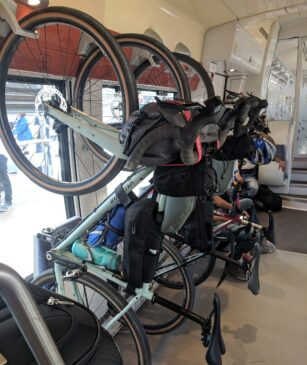 bicycles hanging from hooks in the storage area on french trains