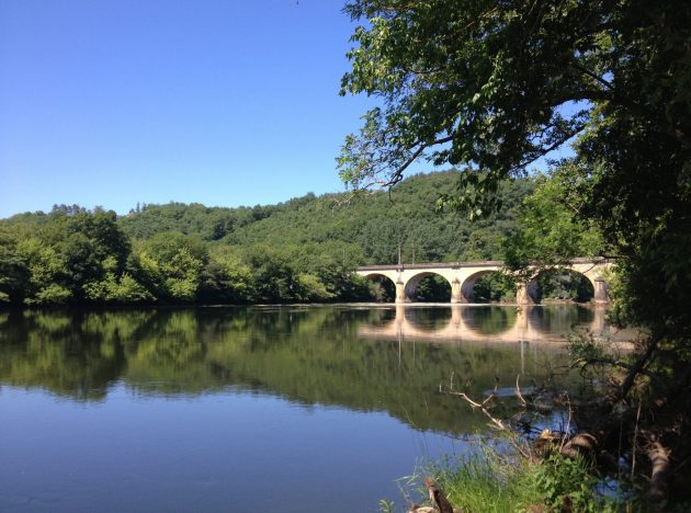 The reflection of a bridge on the Dordogne River