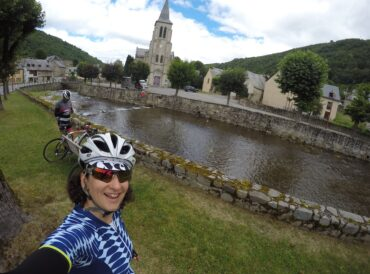 Two cyclists in the French Pyrenees cycling to the Col du Peyresourde