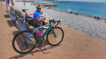 Cyclist eating lunch at the beach of Cagnes-sur-Mer