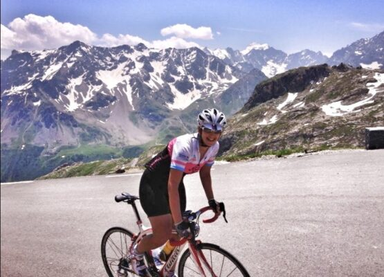 female bike rider on a ride in the French Alps about to summit the famous Col du Galibier