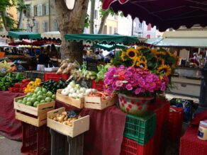 Market stall showing flowers and fresh produce