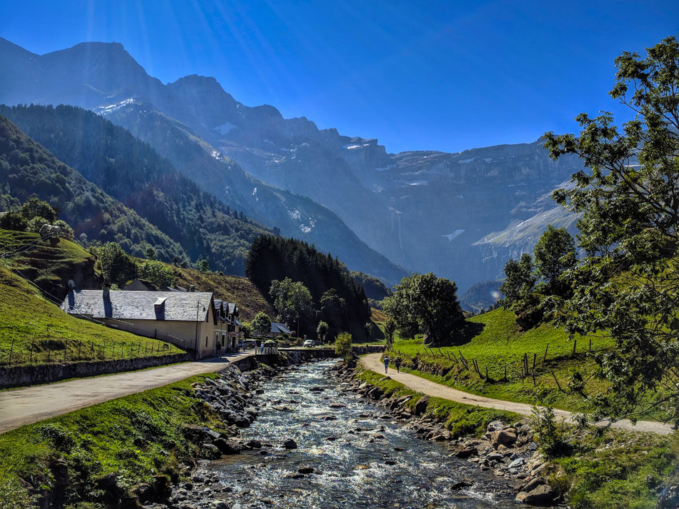 Looking up towards Cirque de Gavarnie in the Pyrenees with a mountain stream in the foreground
