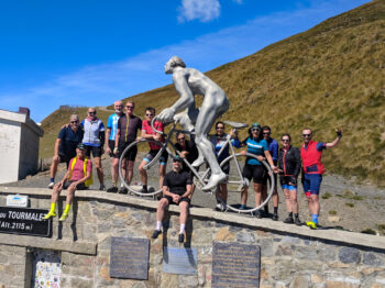 Cycling Tour Group at the summit of Col du Tourmalet in the Pyrenees