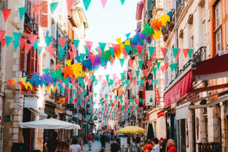 View down a colourful pedestrianised street in Bayonne.