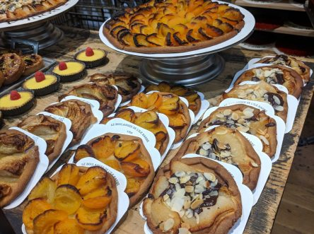 french cakes on display at a bakery