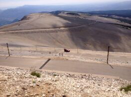 VIew looking down the road of Mont Ventoux with cyclists making their way up the climb