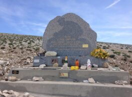 The Tom Simpson memorial on Mont Ventoux adorned with bidons and trinkets from cyclists