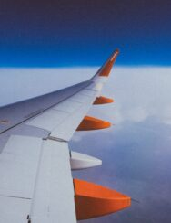 Looking out the window of a plane at the wing