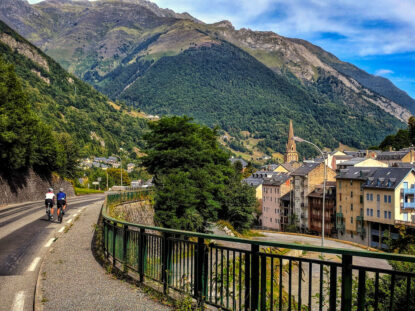 Two cyclists on the road into the ski town of Cauterets in the Pyrenees