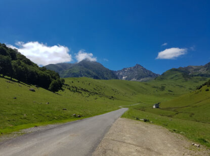 A road through the green slopes of Hourquette d'Ancizan in the Pyrenees
