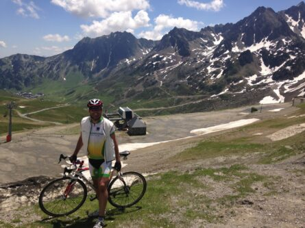 Male cyclist at the summit of the Col du Tourmalet in the French Pyrenees