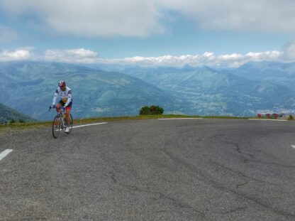 Cyclist reaching summit of Hautacam in the French Pyrenees