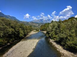 a river view with the French Alps in the distance