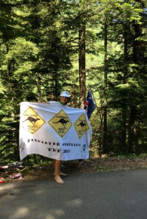 TDF fan with a banner on the roadside