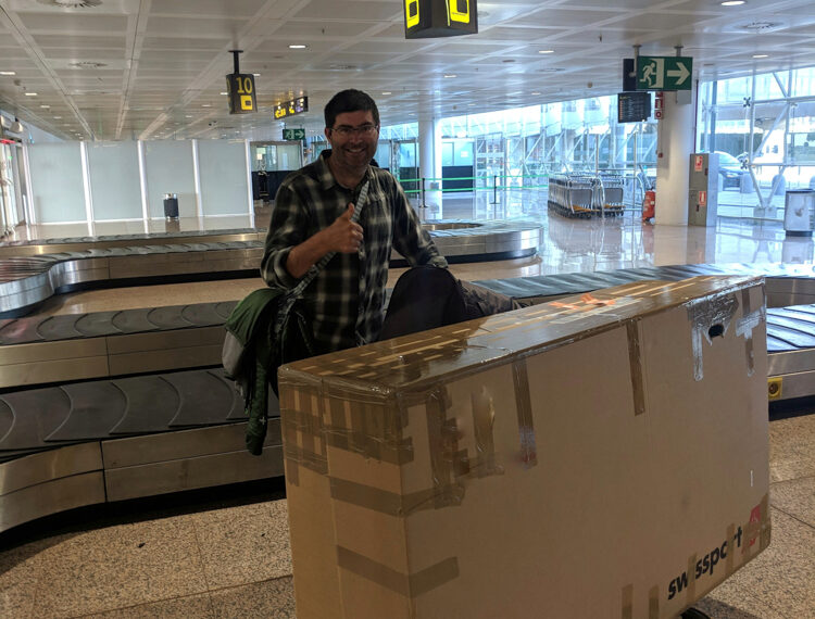 Collecting bikes in cardboard boxes at the airport