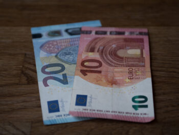 A 20 and 10 euro note sitting on a table in France